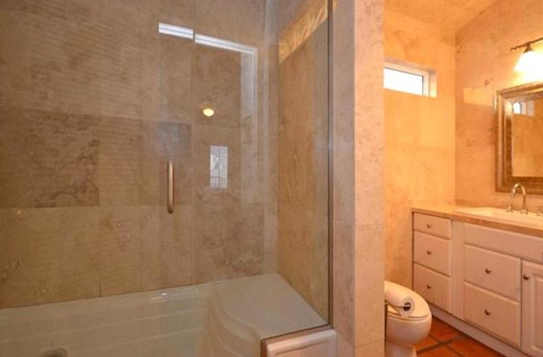 Steam room and shower in one of 2 master baths (travertine)