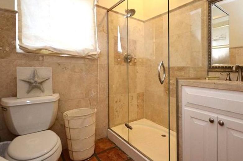 Main floor travertine bath