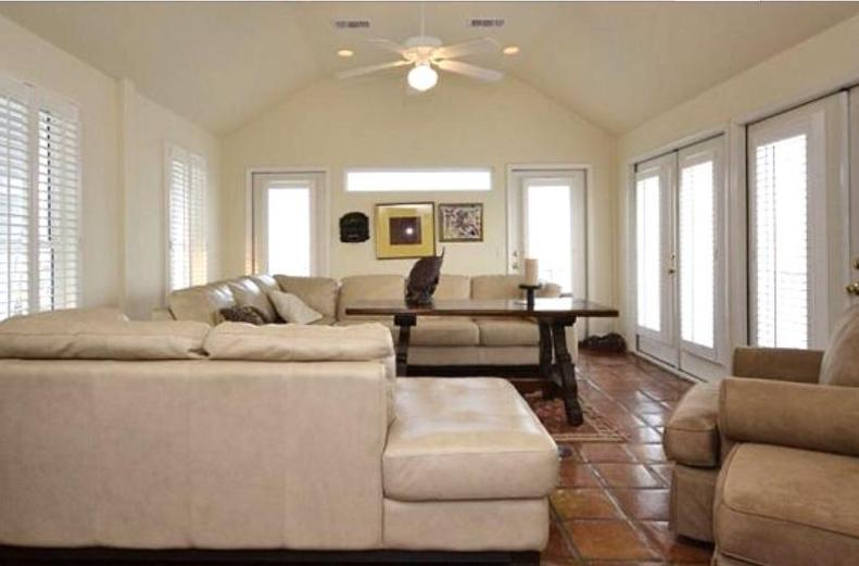 Upstairs living room with fireplace and wraparound deck with open Gulf views (flat panel tv)