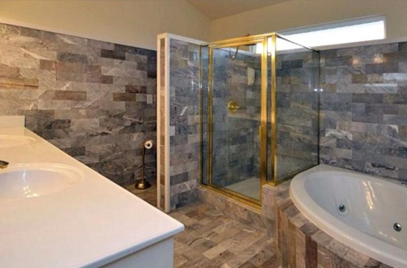 All marble master bath with jacuzzi tub and shower and double vanity