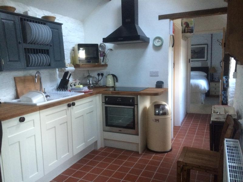 Kitchen beautifully fitted with all mod cons, in a cottage style.