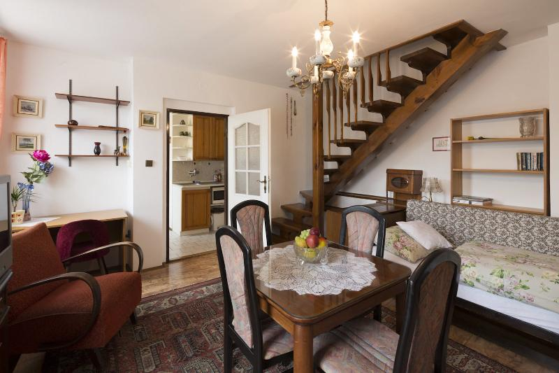 The main dominant of this apartment is a very nice staircase, leading to another apartment.