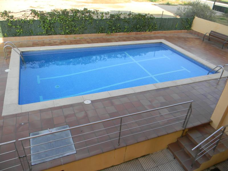Large communal swimming pool area