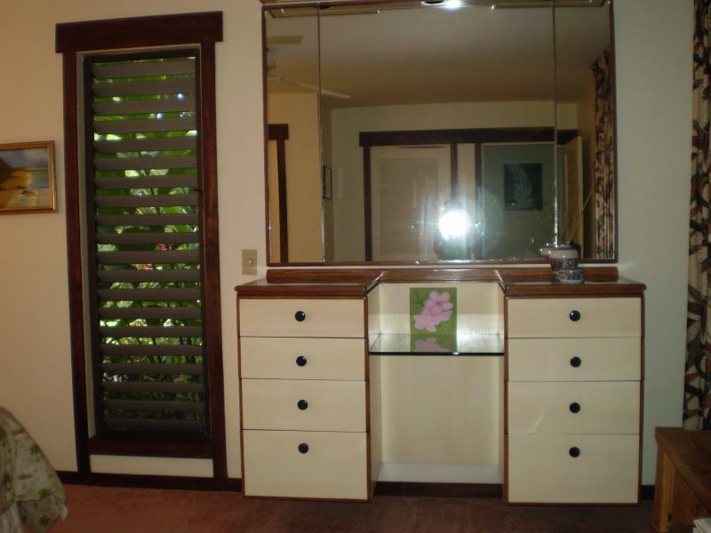 Bedroom dresser with lighted make up mirror.