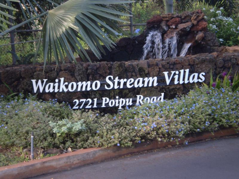Waikomo Stream Villas welcoming entrance with water feature.