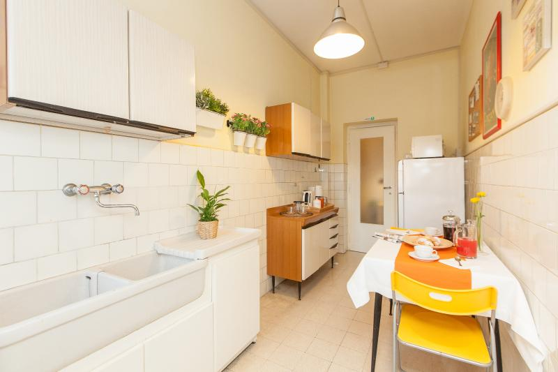 Kitchen with refrigerator / freezer, coffee maker, electric kettle, microwave, gas cooker