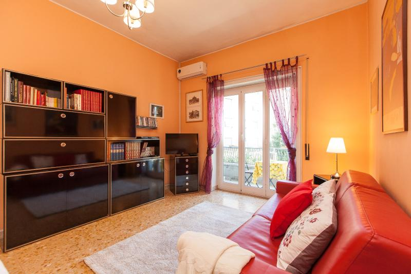 Living room with sofa, library, dining table, lamps, TV SAT and AC