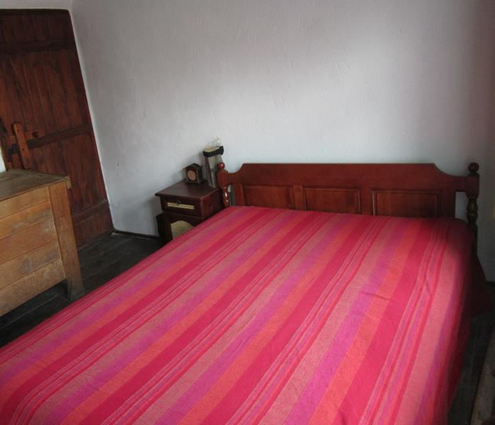 Queen sized bed in master bedroom.