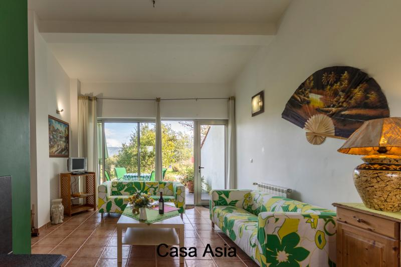 Spacious living room Casa Asia with satellite TV and beautiful furnishings