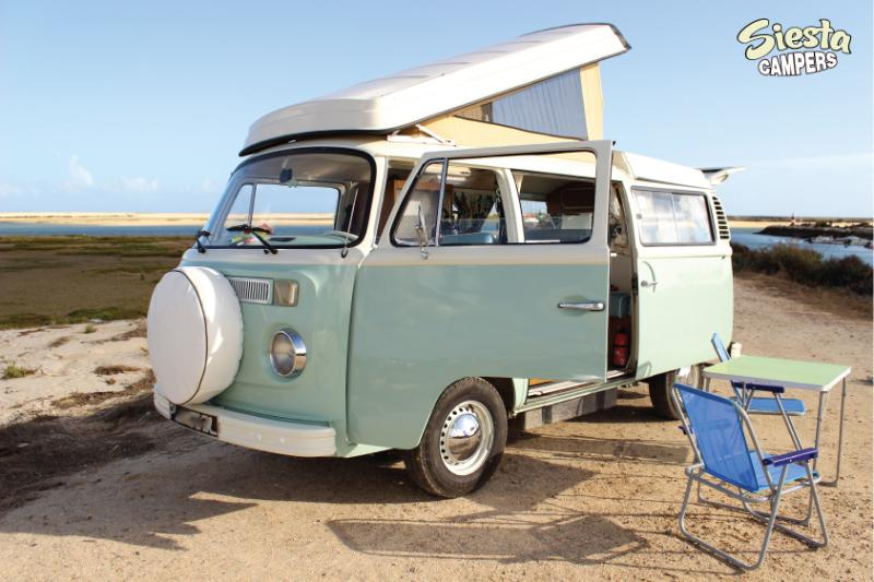 head turning, fully restored VW camper on the beach In Portugal.