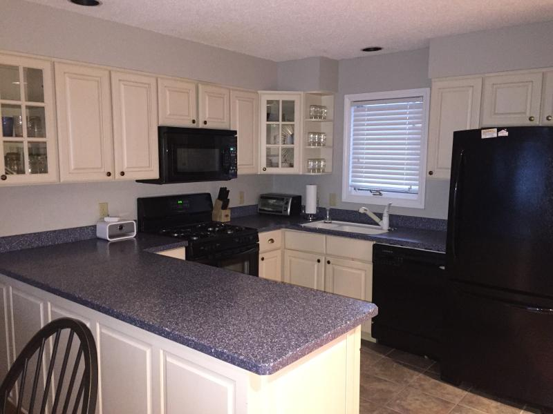 Well-appointed modern kitchen with gas stove and everything you need for a gourmet meal
