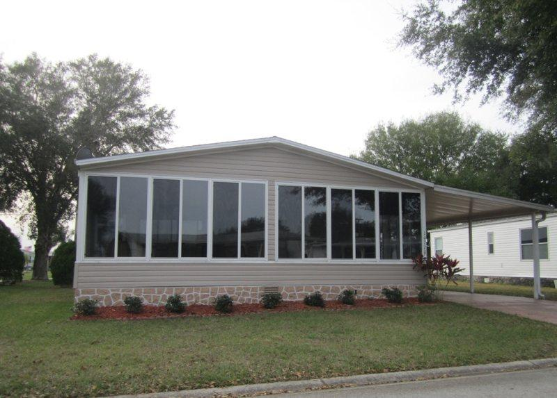 Large home with beautiful enclosed front porch.  Even the rain won't affect your morning coffee.