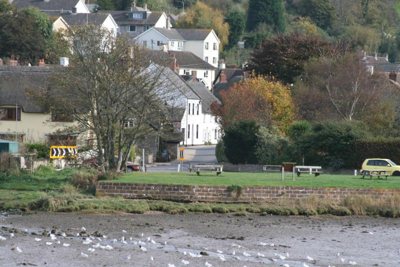 View of Axmouth across the river showing Riverside Cottage