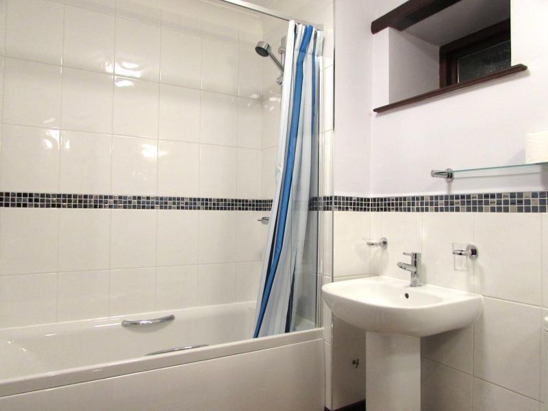 Mill Bathroom with shower over bath