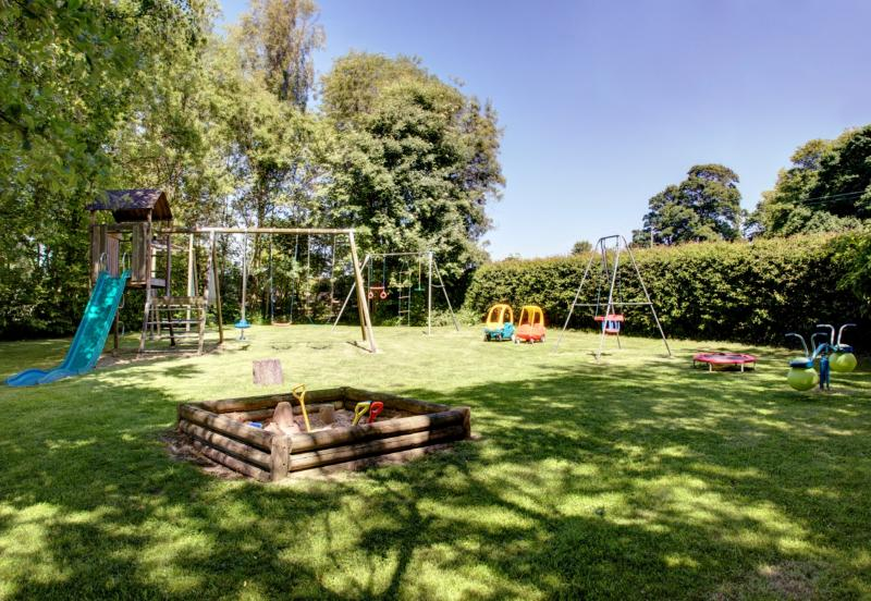 Children's playground with sandpit, swings, slide and outside games