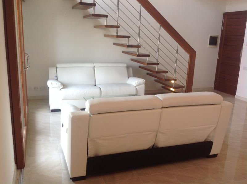 Spacious living area with three 3-seater reeclining sofas