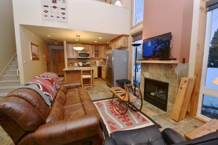 The loft-style condo allows for vaulted ceilings, which creates an open and airy feel to the property.