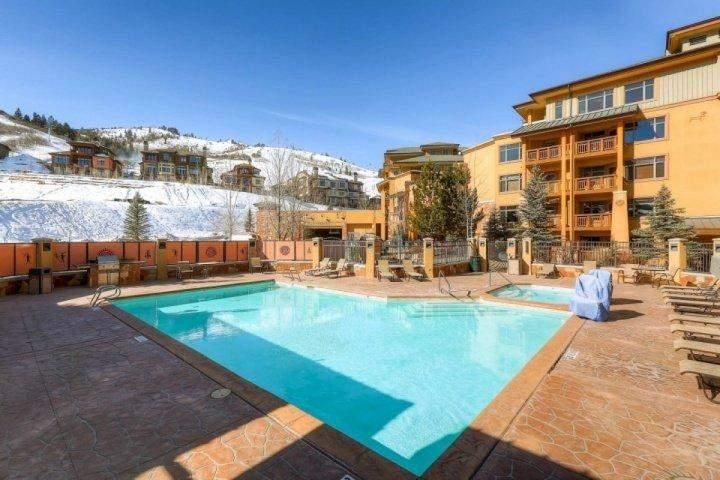 Sundial Lodge Outdoor Pool with views of the Wasatch Mountain Range.