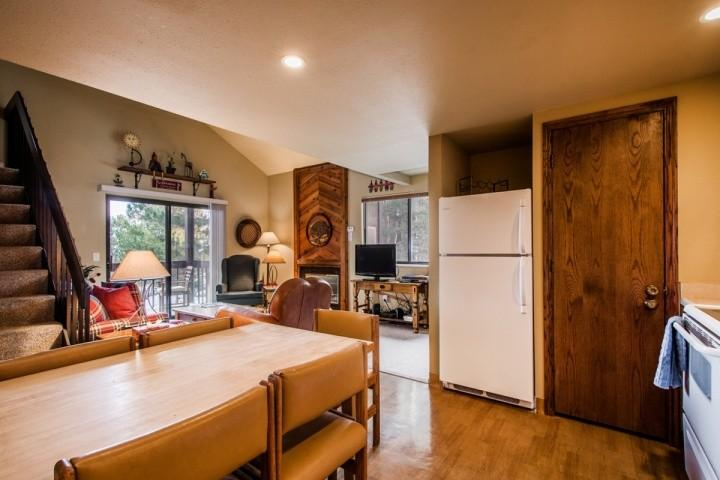 Dining area with seating for six, fully equipped kitchen.