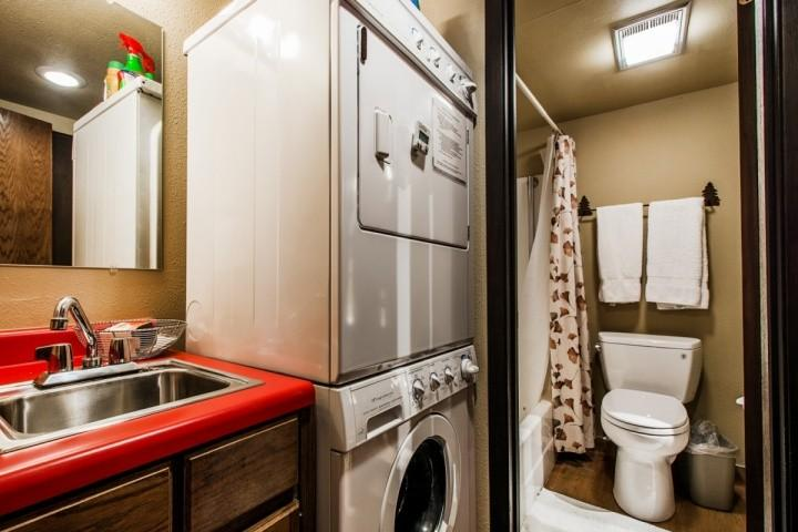Laundry room with washer, dryer and sink.