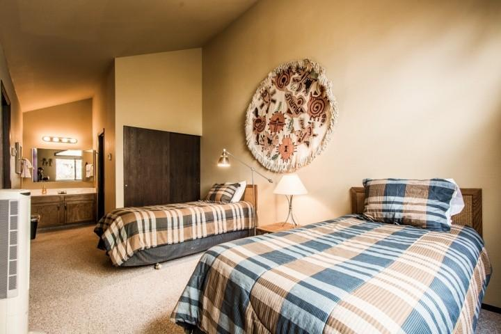 Guest bedroom (2) in the loft offers two twin beds and vaulted ceilings.