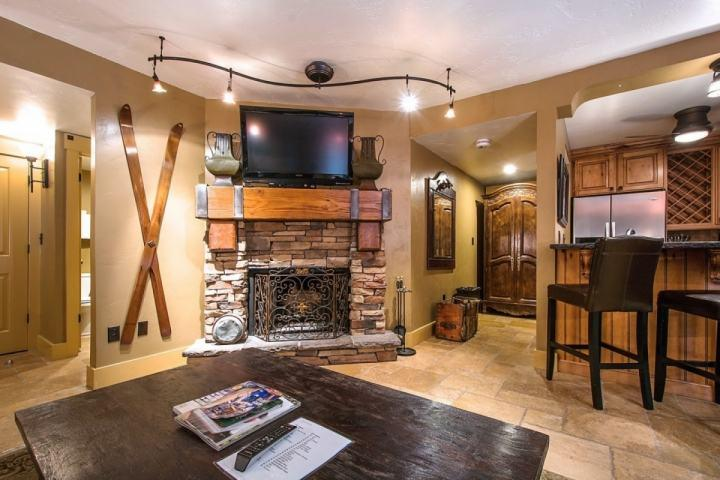 The living room also features a laptop / desk nook and access to the private balcony with mountain views of Park City Mountain Resort.