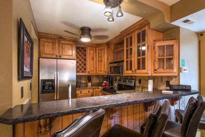 The new Chef's kitchen features brand new stainless steel appliances, beautiful hardwood cabinetry, granite counter tops and slate tile flooring.