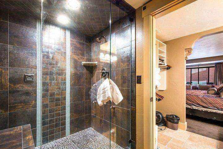 The first master bathroom has also been fully modernized with granite countertops, large glass encased steam shower and new hardwood cabinetry.
