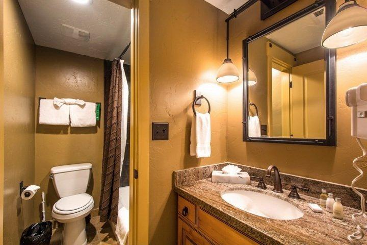 The second master bathroom is properly equipped with a soaker tub and shower, granite countertops, stainless steel fixtures and new lighting finishes.