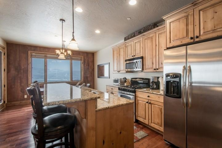 There is tons of counter space to prepare and entertain friends and family and the counters are also nicely finished in a light speckled granite stone