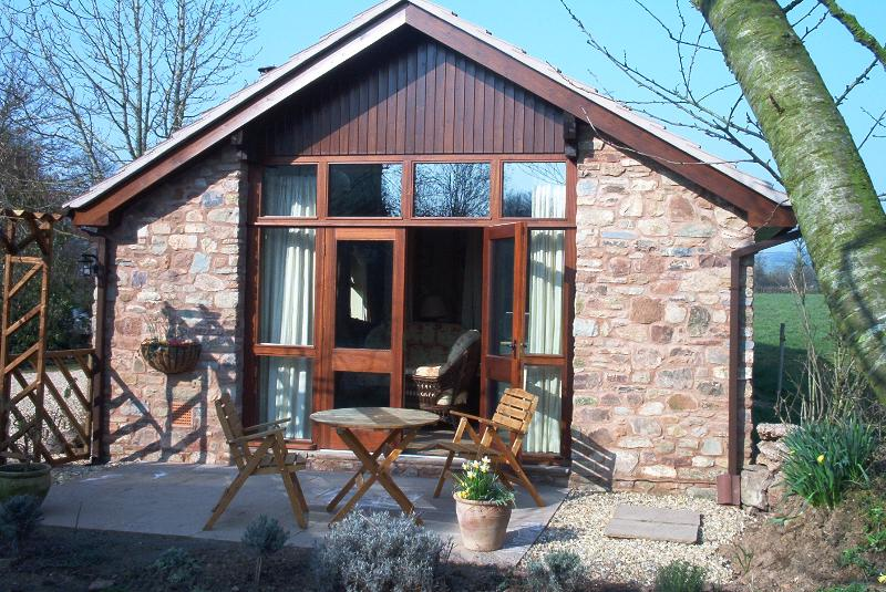 Sunny south facing doors, opening on to the patio. Ideal for BBQ's