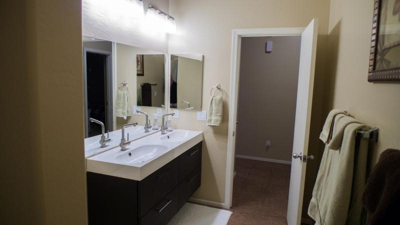 Main Bathroom with double sinks tub and shower combo.