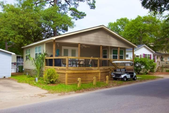 This spotless two bedroom, two bath house has it all, golf cart, Parking for 2 cars.
