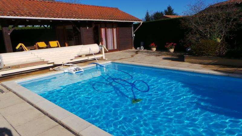 access to outdoor heated swimming pool