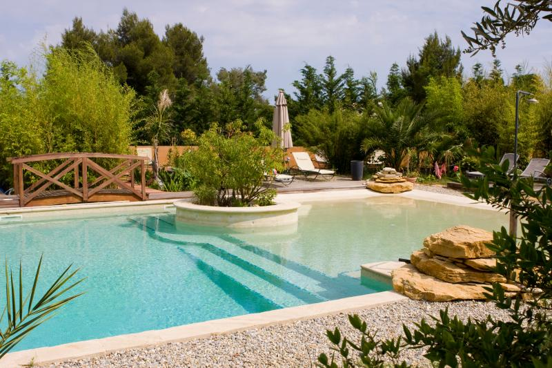 SWIMMING POOL, A LARGE BATHROOM AND A BEACH FOR THE LITTLE ONES AND THE SOLARIUM TERRACES...