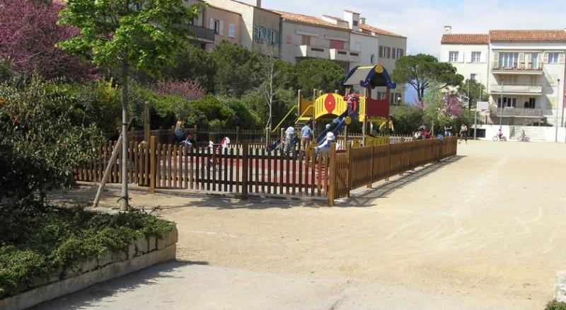 Playground area for young children.  Beside a small supermarket, bakery, café/snack, hairdressers