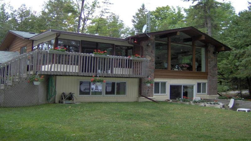 Front of cottage, view from lake. Upper and Lower Suites-2,600 s.f., large deck
