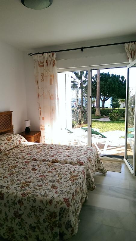 Master bedroom with patio door to private garden
