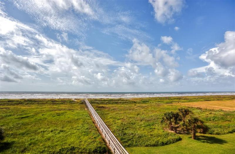 Admire breathtaking views overlooking the beach and Gulf of Mexico from the unit's private balcony