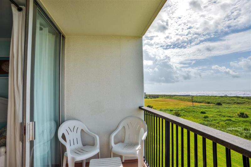 Relax on the private balcony while taking in the soothing ocean breeze