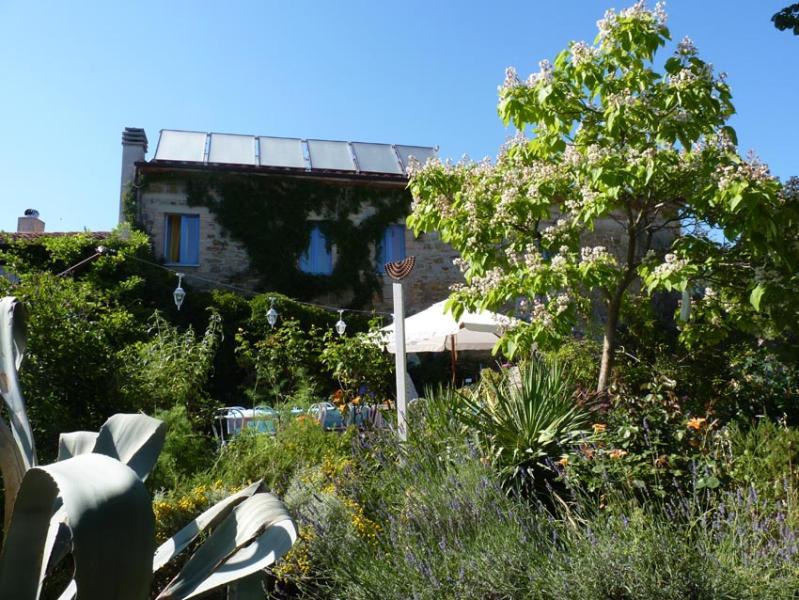 Villa La Rogaia is nestled in a lush garden