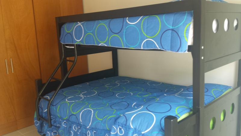 Bedroom with bunk bed, which consists of double bed and two single beds