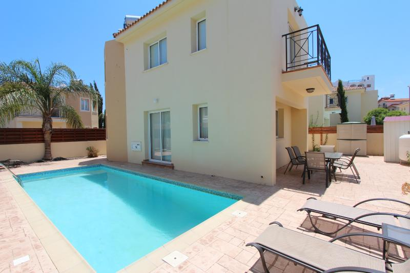 Poolside showing rear area and patio doors