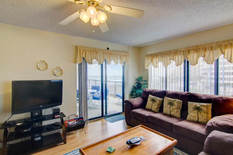 Bright Living Room with   Queen Size Sleeper Sofa and Walkout to Large Balcony.