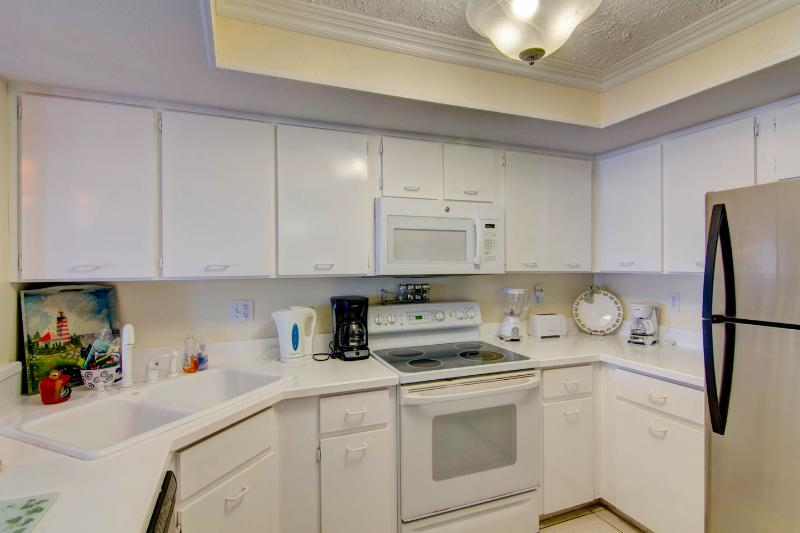 Immaculate Roomy Kitchen with Stainless Steel Refrigerator.