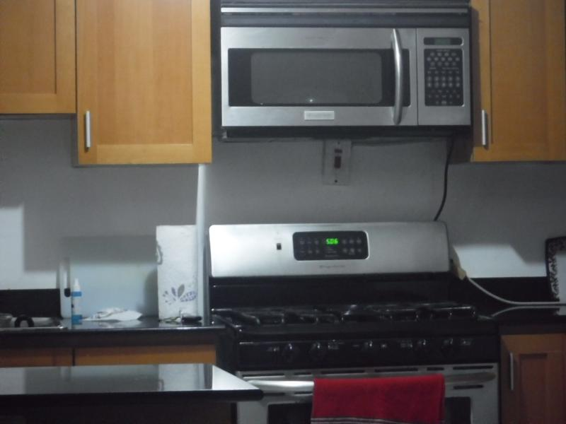 Microwave, fridge, gas stove for making a perfect dinner