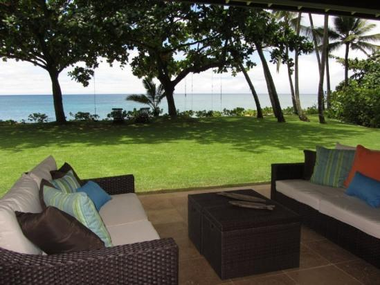 Outdoor lanai and beach front yard