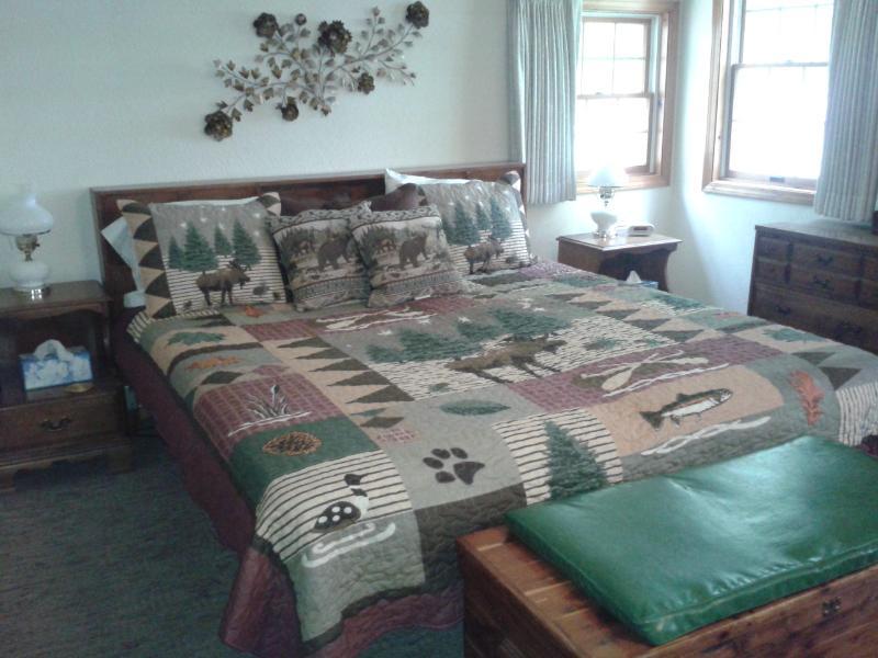 Dormitorio con un rey de Cal