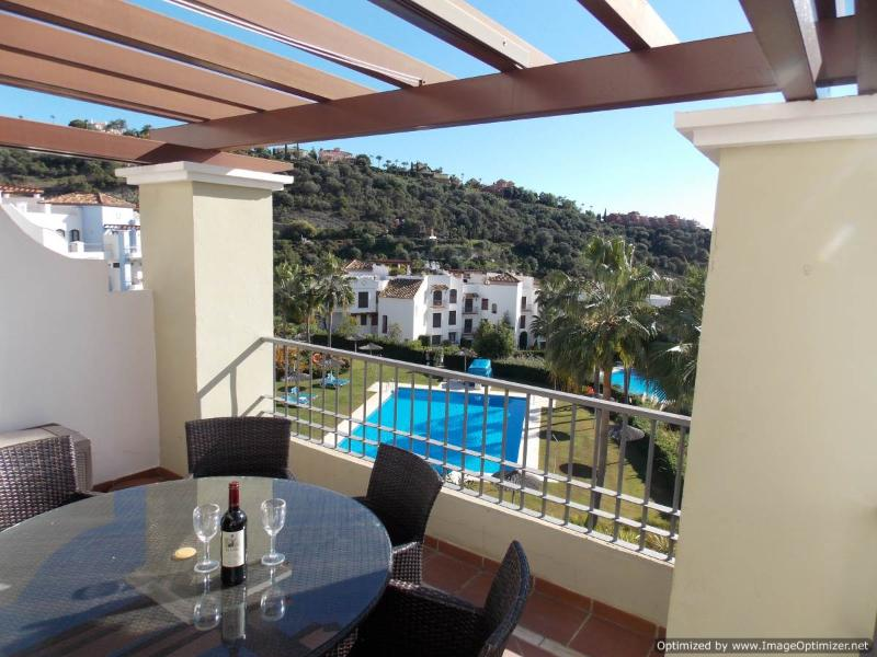 private terrace overlooking swimming pool