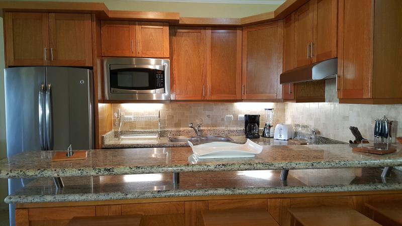 Our attractive, fully equipped kitchen offer a focal point for the whole apartment.